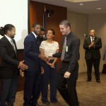 Team Leaders Congratulate Corps Member Robert Malcolm