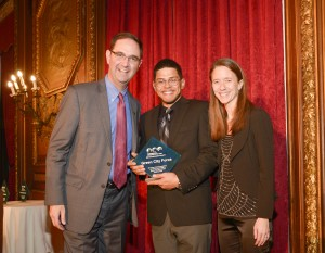 Miguel and Lisbeth accept the Advocate Award on behalf of Green City Force.