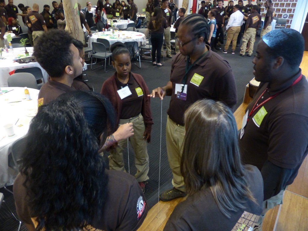 Corps Member Sadiqua Minor (center) discusses service with her fellow Corps Members at the Youth Summit.